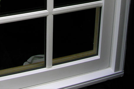 Exterior view of casement window with simulated divided light